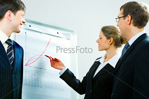 Image of successful woman explaining business-plan to her colleagues