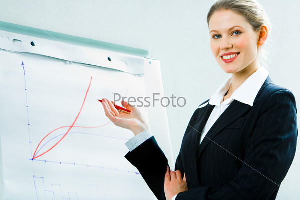 Image of business woman in suit showing a project