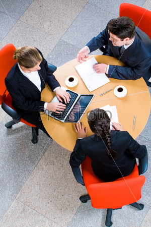 Vertical image of business people working at meeting