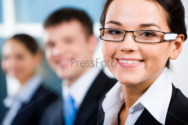 Portrait of business team in row with clever leader in front