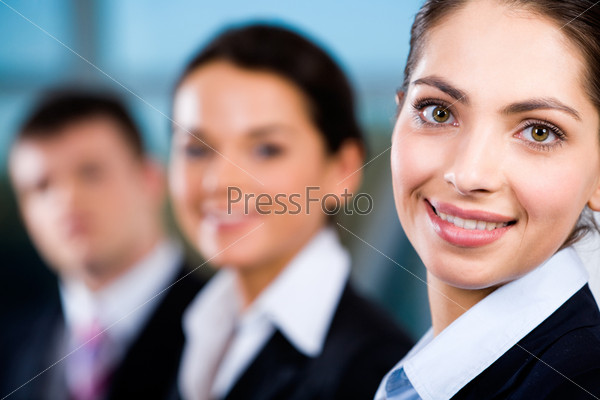 Line of business people's faces with beautiful woman in front