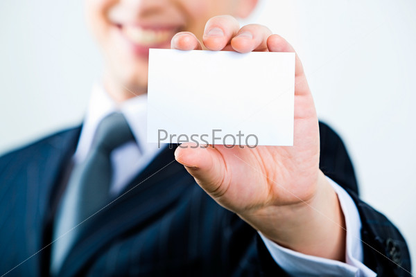 Image of business man holding a visiting card