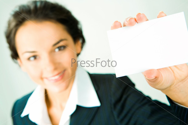 Business woman in suit showing her visiting card