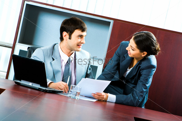 Portrait of two business people looking at each other during work