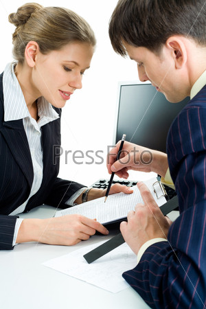 Portrait of confident man showing a business-plan to colleague