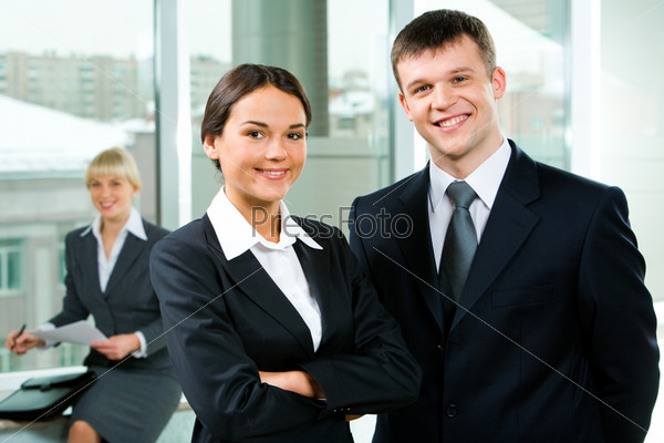 Portrait of business partners standing alongside in the office