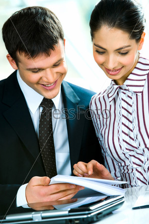 Portrait of business man and woman working together