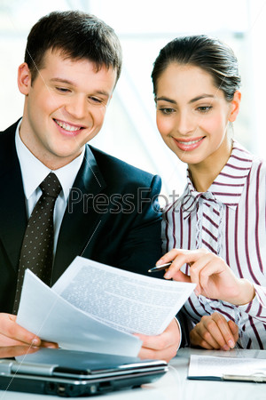 Portrait of a businessman and a businesswoman  discussing new business plan