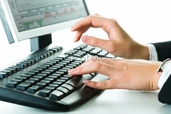 Image of businesswoman's hands typing a letter on the keyboard