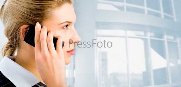 Profile of confident businesswoman's face with her hand holding cellular phone