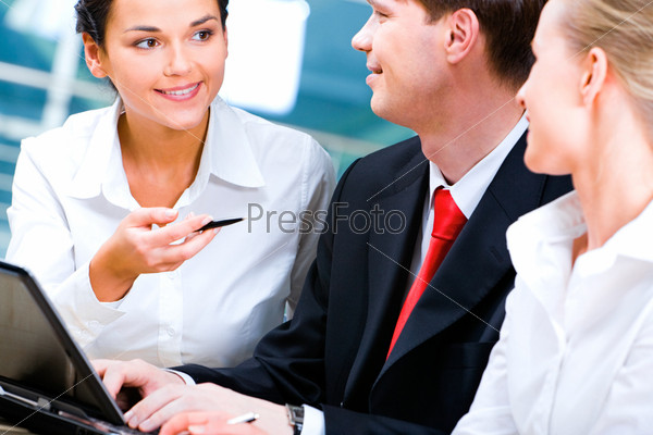Photo of attractive business leader explaining her business strategy to the partners