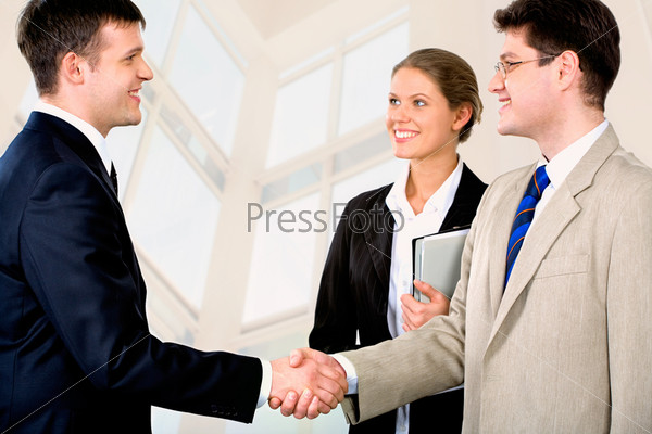Portrait of two successful business partners shaking each other's hands