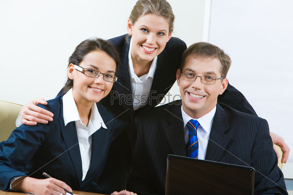 Portrait of three smiling business people looking at camera