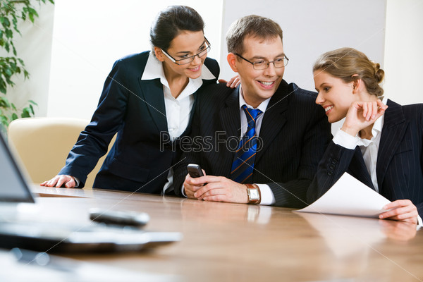 Image of business team sitting at the table in the office