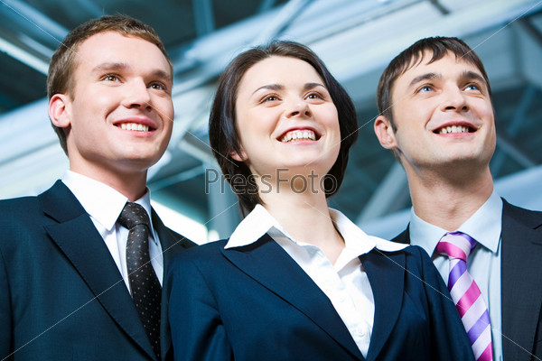 Portrait of business woman between two confident men