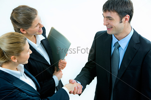 Conceptual photo of business people shaking hands and smiling