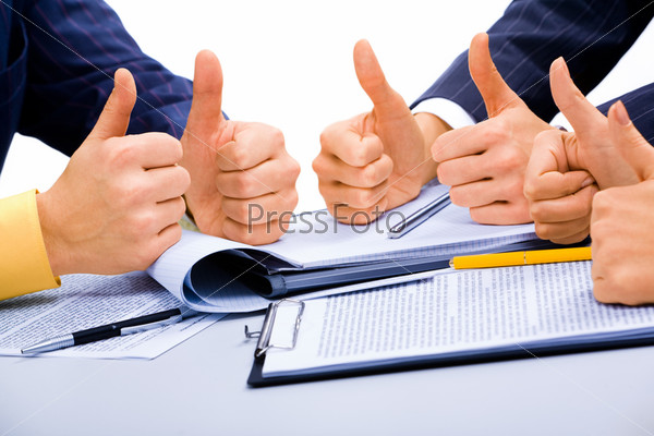 Success in business: people giving the thumbs-up sign