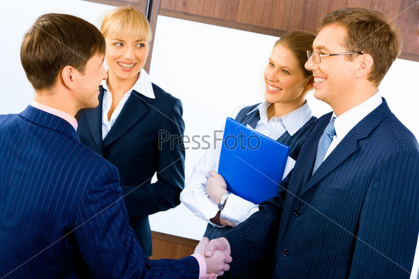 Business people shaking hands making an agreement at meeting