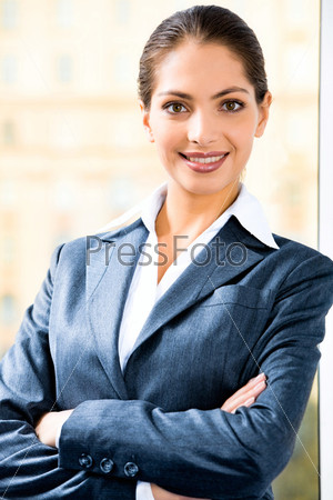 Portrait of attractive business woman in suit folding her arms