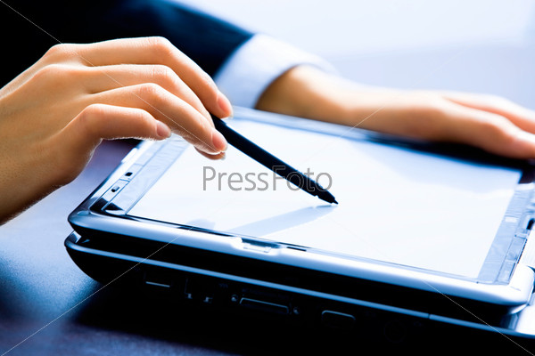 Image of female hands making a demonstration pointing at laptop