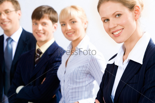Portrait of business leader with her working team