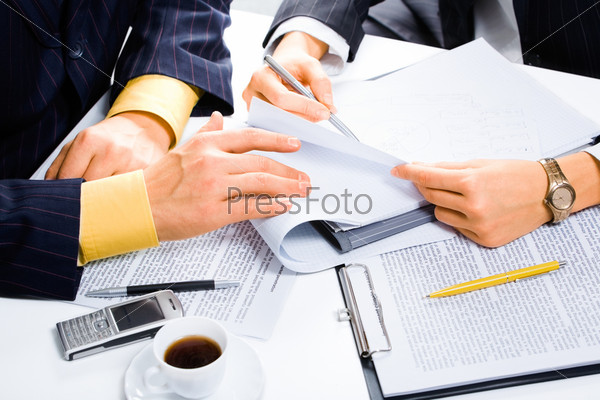 Image of people's hands during business conversation at meeting
