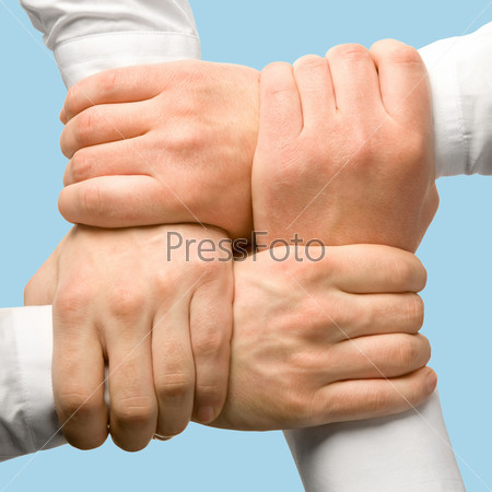 Photo of business people's hands touching each other