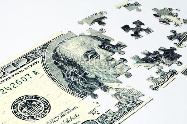 Image of dollar made of puzzles over white background