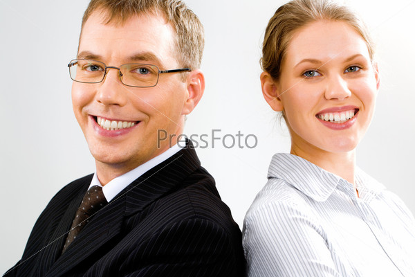 Portrait of two smiling business people looking at camera