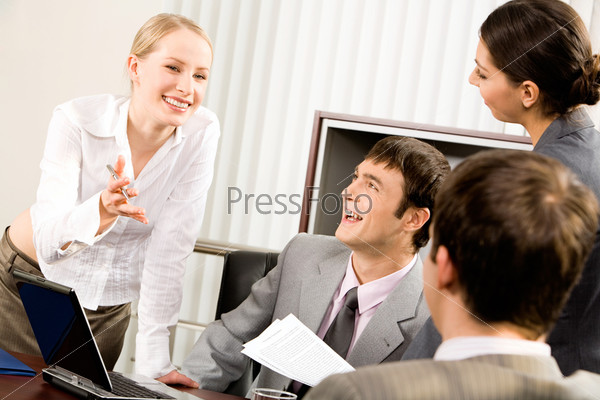 Portrait of business woman explaining her new working idea to co-workers in the office