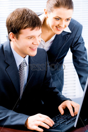 Portrait of two confident business people working together