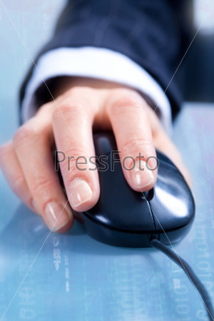 View of businesswoman's hand using a computer mouse doing a project