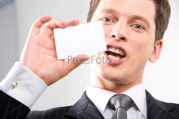 Portrait of business man presenting a cut-away to somebody