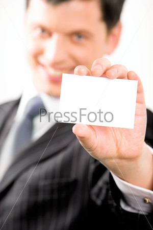 Image of confident entrepreneur with salutatory card in his hand