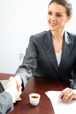 Creative image of business woman making an agreement with her partner