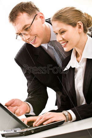 Successful business team of two people working over a laptop