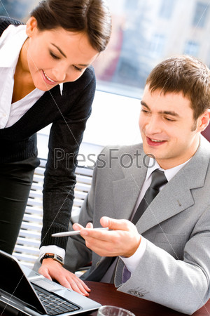 Business woman and man discussing a working idea in the office
