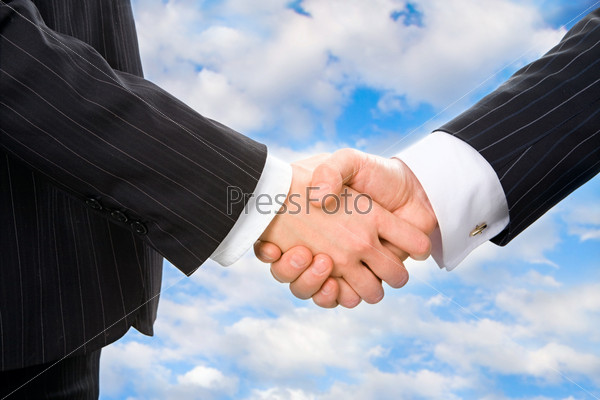 Image of handshake of partners isolated on a sky background