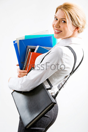 Portrait of a business woman with a pile of folders in her hand looking with smile