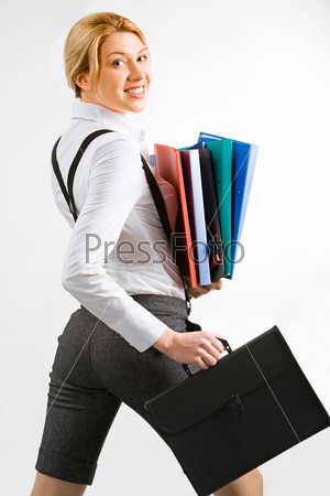 Portrait of student or teacher holding folders and briefcase on a white background