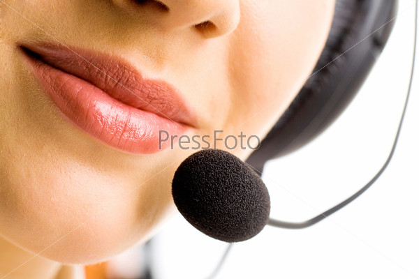 up of business woman\'s lips with microphone