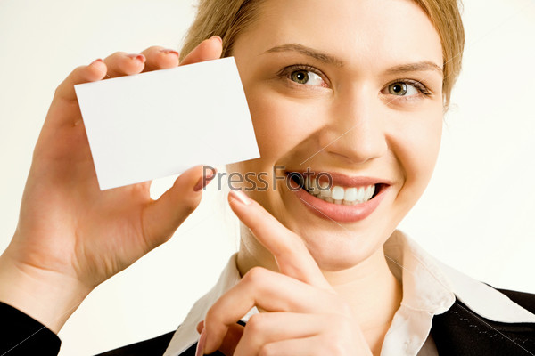 Image of pretty business woman holding a white business card pointing to it