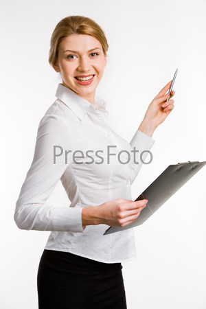 Portrait of smiling confident business woman with pen and folder