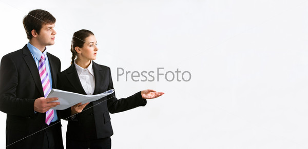 Image of two business people holding a document and looking at something