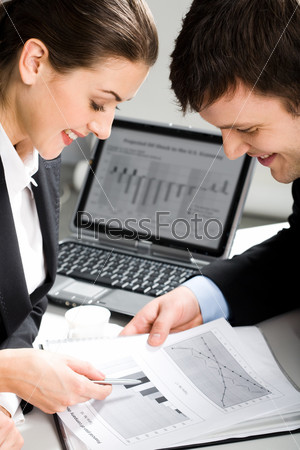Image of two business people planning a new project in a working environment