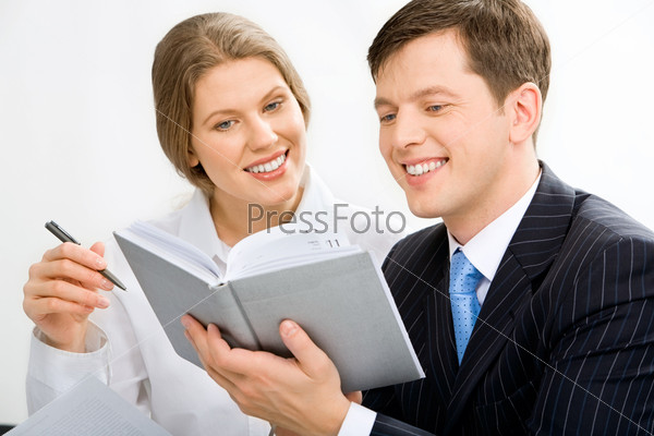 Portrait of attractive secretary and boss discussing schedule of works