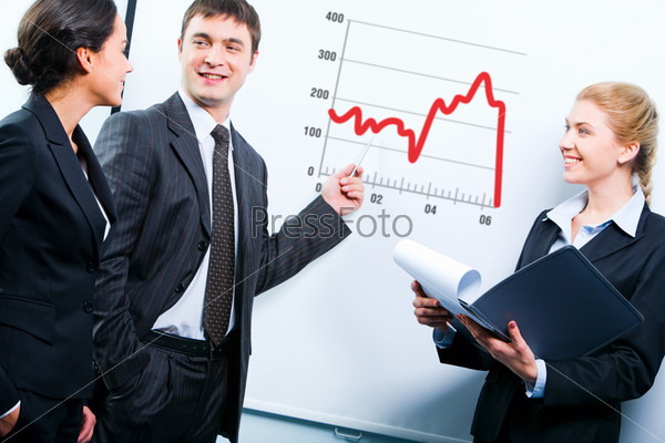 Portrait of teacher demonstrating a graphic of development strategy to students