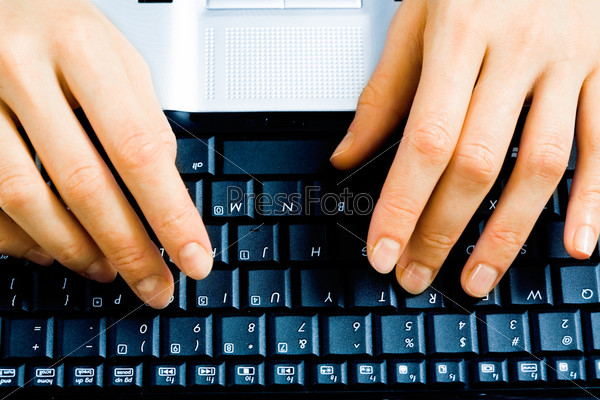 Image of businesswoman's hands pressing keys of a laptop
