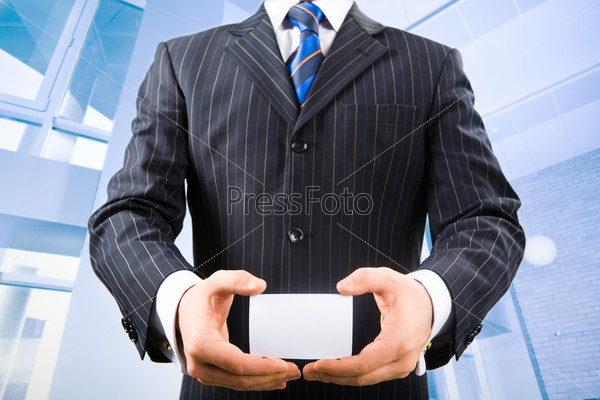 Photo of business man holding his visiting card in the office