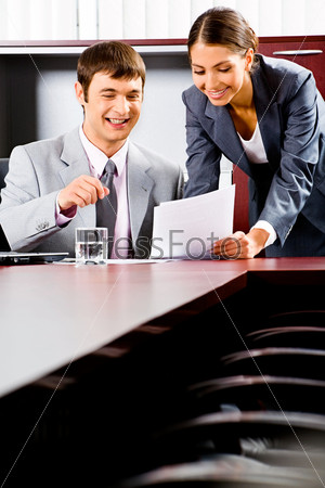 Portrait of business man and woman working together in the boardroom